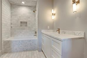All of the bathrooms are finished with marble countertops and flooring.  Please note the secondary bathroom mirrors and cabinet hardware will be installed soon.