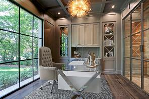 A beautiful picture window and encased wine storage highlight this fabulous study, while wide plank French oak flooring and contemporary lighting lend additional style.  **Please note the photos are virtually staged.
