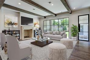 Beautiful fir beams, a hand-carved limestone mantle, and a masonry fireplace add wonderful texture to the family room.