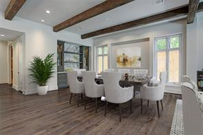 The dining room is pre-wired for a chandelier or other lighting fixture. Additionally, the custom wet bar is beautifully appointed with a slab marble backsplash and countertop, lighted cabinets with glass shelving and an ice maker.