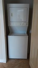 The stack washer and dryer are located inside the condo.