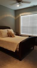 Master bedroom is a good size. A kingsize bed will fit in the room. It has brand new carpet and views of Lake Conroe.