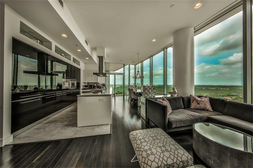 Fabulous opportunity to live in a gorgeous unit in one of Houston s premier high-rises located in the heart of Upper Kirby adjacent to prestigious River Oaks. This spacious gem is an architectural masterpiece. The residence features 12 ft. floor-to-ceiling windows with breathtaking views of tree covered River Oaks and the Galleria. Semi-private elevator, Italian Snaidero kitchen w/the finest European appliances.