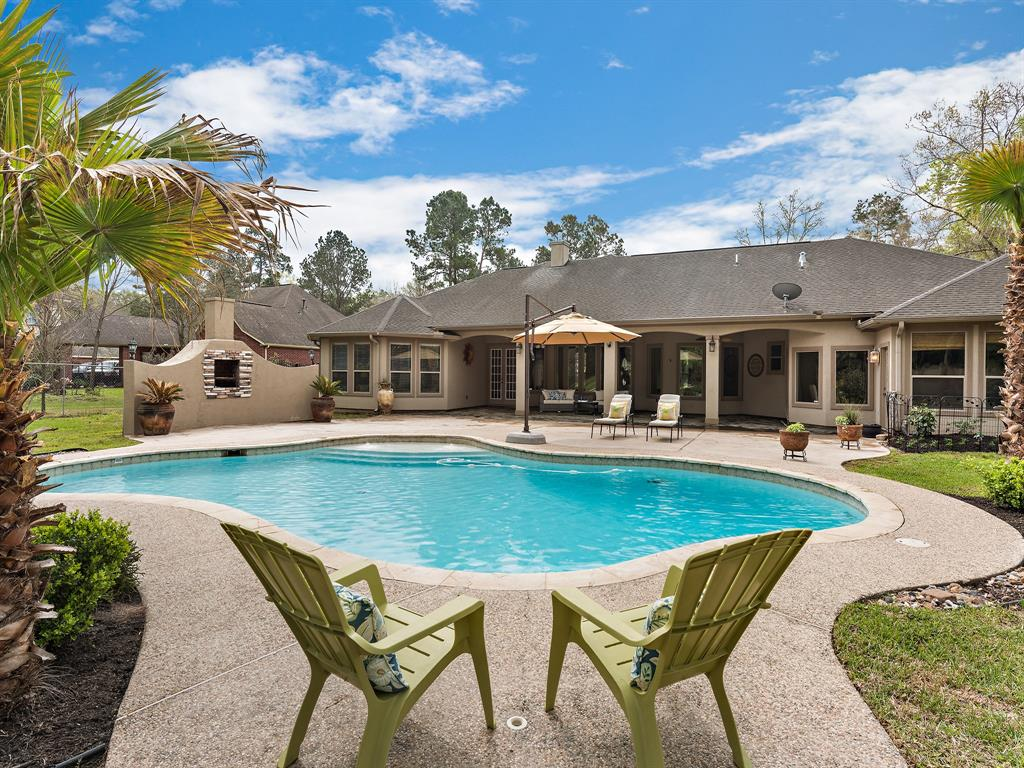 Tastefully appointed custom home w/pool situated on quiet CDS lot! This elegant split plan has it all - high ceilings, custom millwork, art niches & built-ins thruout. Extensive tile flooring in living areas. Amazing gourmet island kitchen w/granite counters & stainless appliances features large breakfast bar w/stone surround & sep. breakfast room overlooking den w/FP & built-ins. Formals w/triple tray ceilings. Study w/FP & French doors. Huge Master suite with private entrance and spa-like bathroom.  Huge cov'd patio area overlooking pool and outdoor FP!  Community offers private 66-acre lake, park, & social events!
