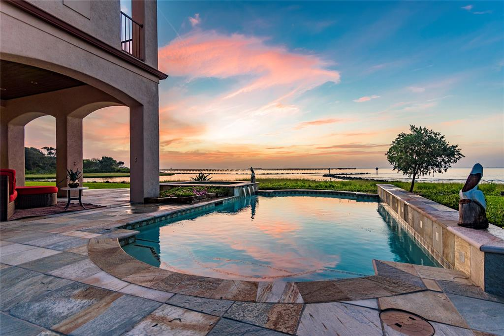 "Stunning Bayfront custom home by Masterpiece Homes.  This is an incredible find with all of the appointments and features you expect from this builder.  The home boasts an open concept with walls of windows, ""miles"" of balconies, chef's island kitchen with granite clad counter tops, designer stainless appliances and more. Elegant master suite with incredible views of the bay, a spa quality bath with Jacuzzi tub, glass enclosed separate steam shower and large walk in closets. Gorgeous rich wood flooring on the first level with most recently installed. Crystal pool/spa. Elevator to all three levels, six car covered parking with open pavilion overlooking the bay. Perfect place to enjoy the serenity of a morning sunrise and the drama and beauty of a sunset over the bay. Call for a personal tour!"
