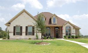 Welcome home!  Fantastic one story home has Austin Stone and brick throughout.  Shutters and beautiful landscaping around the front.
