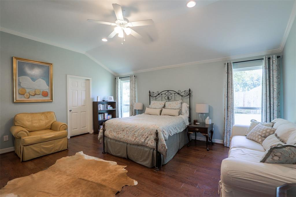 The Master bedroom includes wood floors, high ceilings, recessed lighting, and should offer plenty of room for a king sized bed.