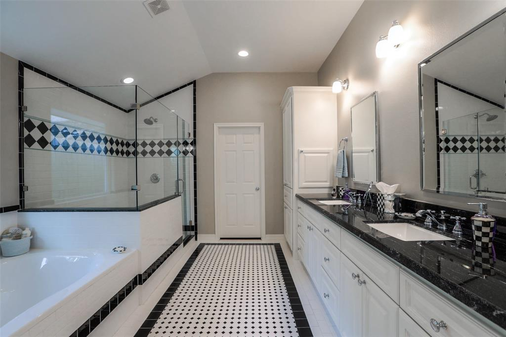 There is plenty of elbow room in this large master bathroom. Check out the large separate shower and soaking tub.