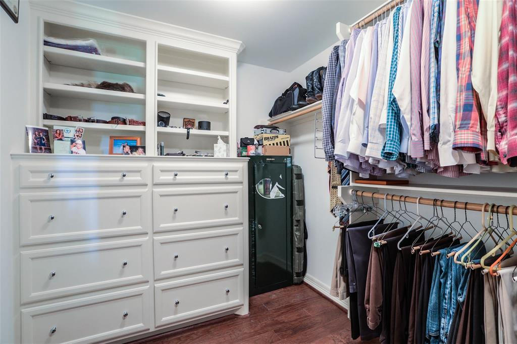 Built-ins in the master closet provide great space saving storage.