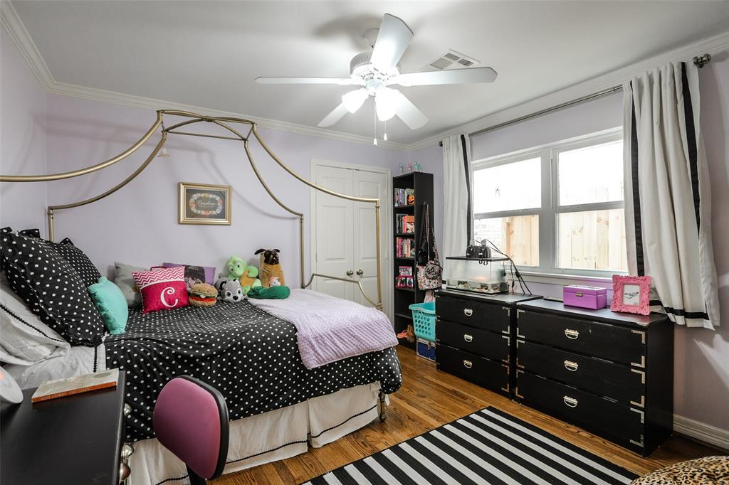 One of 4 bedrooms. Includes ceiling fan, crown molding, and a generous closet.