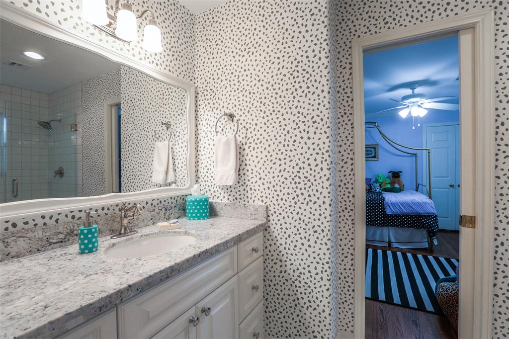 This renovated bathroom connects two of the bedrooms.