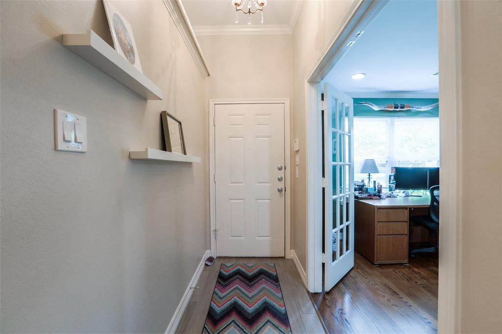 Throughout the home, you will find a mix of beautiful tiled floors and original hardwoods. The large study is located just off the entryway.