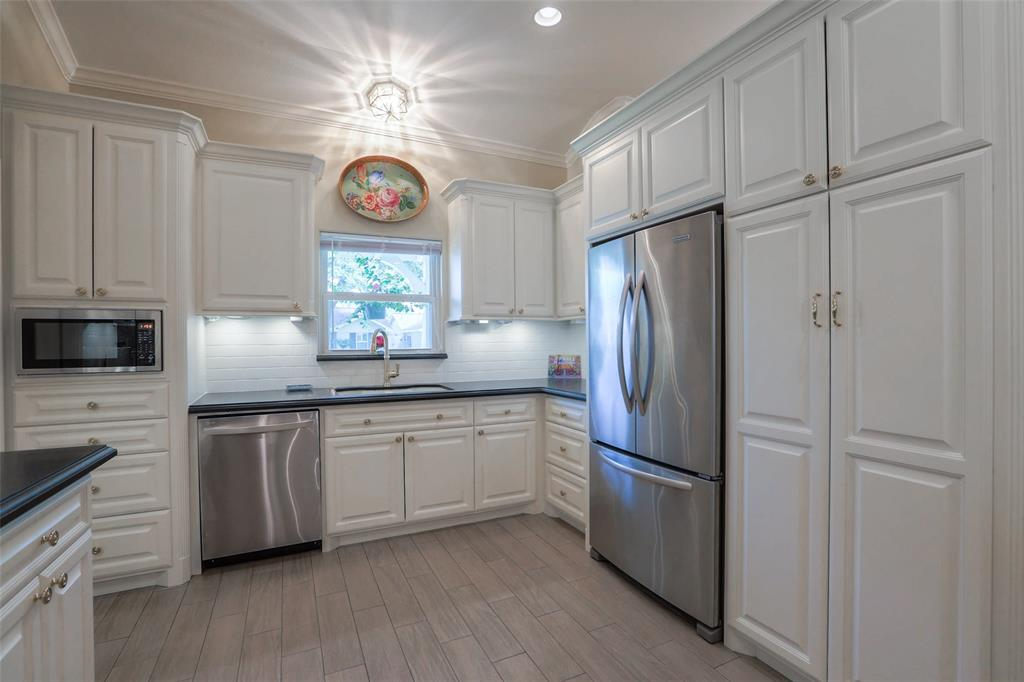 Tons of storage in this large open kitchen.