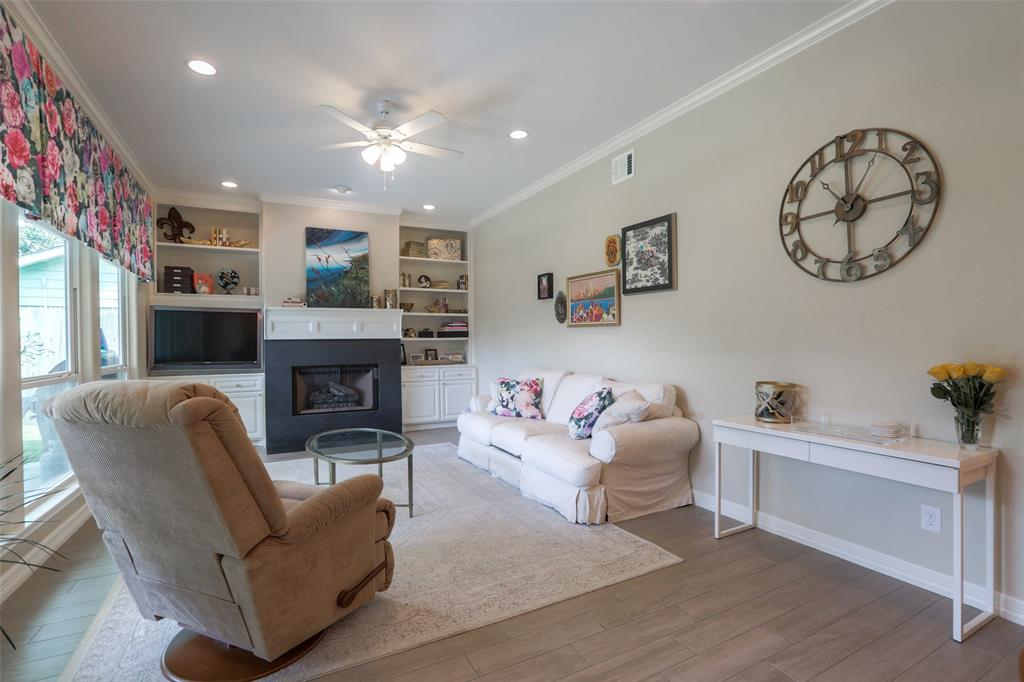 The living room includes custom built-ins, crown molding, and a great fireplace.