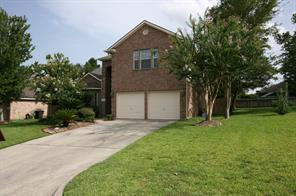 Nicer two story brick home located towards the back of a small culdesac within Walden on Lake Conroe.