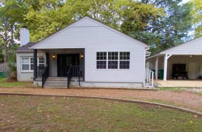 A must See!!!!! Precious 3 bedroom 2 bath home in walking distance from downtown. You will find 1,629 square feet of living space with central air and heat, along with a tankless hot water heater. This home offers a circle drive with a two-car carport with bonus storage area. Inside you will find beautiful new wood tile flooring in the living room, kitchen, dining, guest bath and the front bedroom. The separate dining room offers a beautiful view to the front yard and sliding glass door onto the front porch. The backyard offers .375 acres perfect for entertaining, play area for kids and animals.  Call today to see this beautiful home and all its charm.