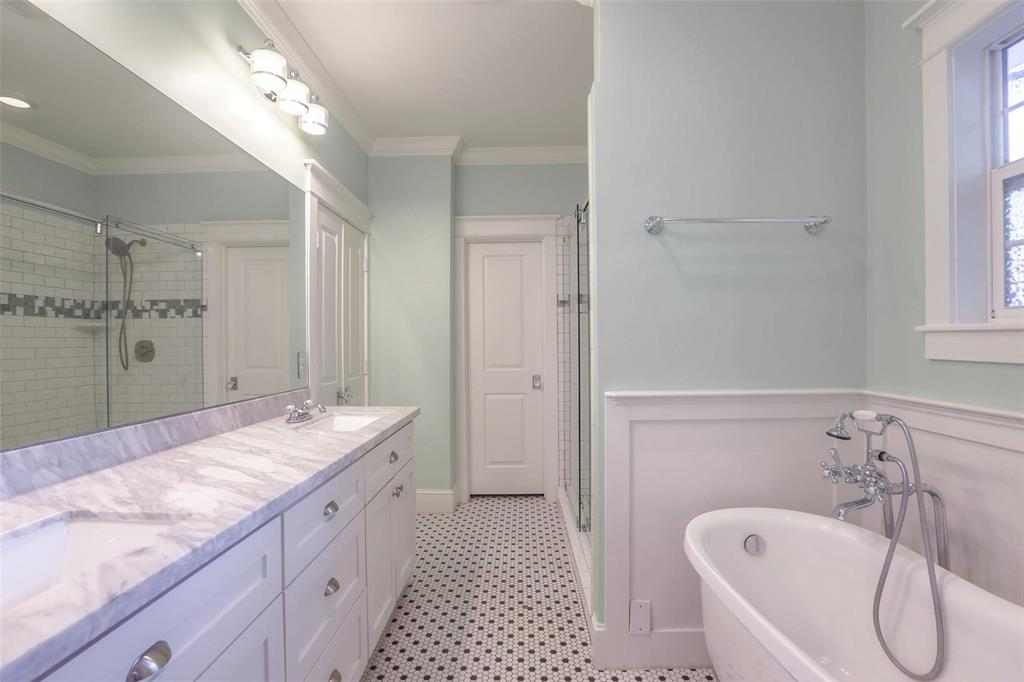 You are going to love this beautiful master bath with double vanities and a beautiful free standing tub.