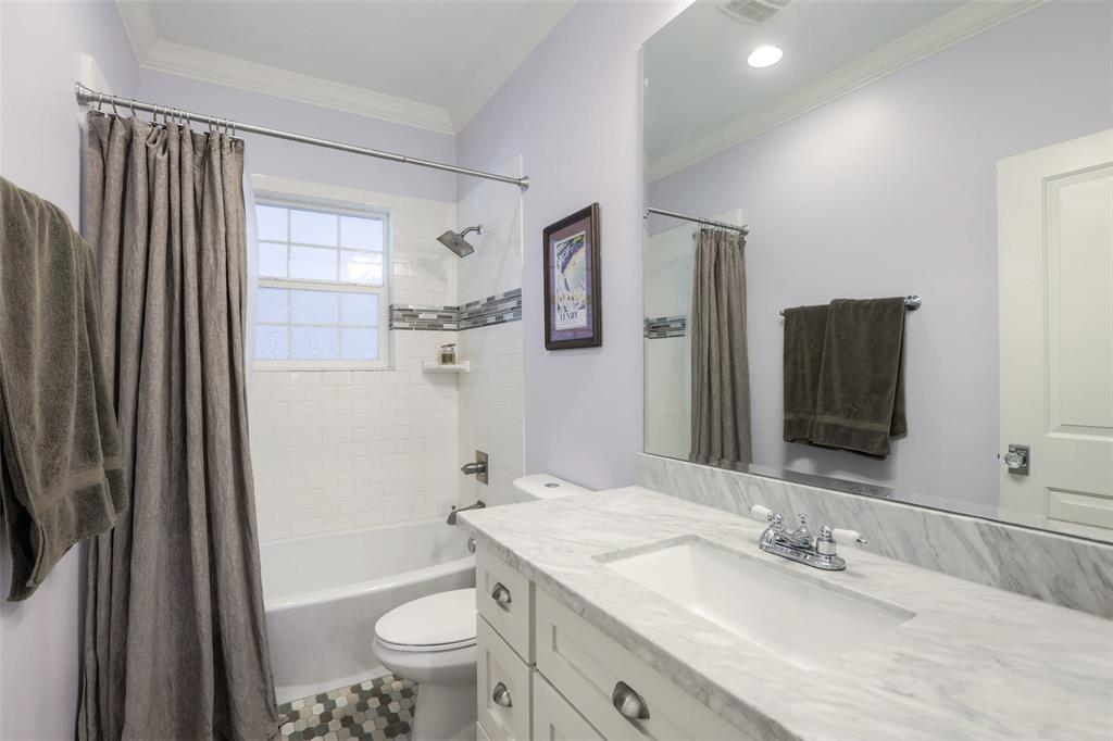 The large secondary bathroom is located near both guest bedrooms.  It has some beautiful tile floors and Carrara marble counter-tops.