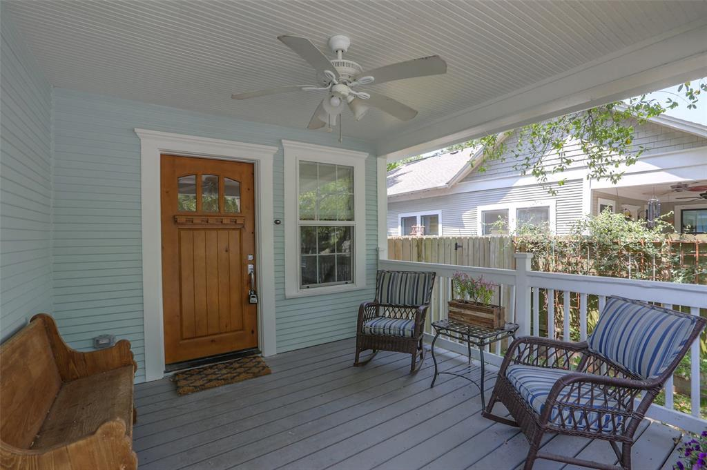 You will love spending time with neighbors and friends on this wonderful front porch.