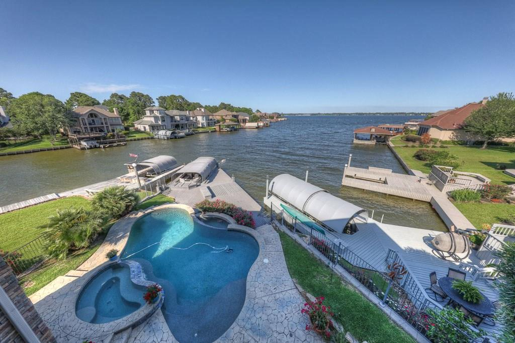 The view is breathtaking from this beautiful waterfront Bentwater home.  Open water views from the end of a wide quiet cove.  It is not subject to the wind, noise, traffic and waves of the open lake.  Built by prestige builder, Jim Morris, this home has 60+ foundation piers, outdoor kitchen, pool, granite counter tops, top of the line appliances and too many features to list.  Home mixes luxurious finishes with a warm and inviting feel.  Extra room or study could be converted to fourth bedroom it needed.  Complete with an elevator and open design, this is a perfect home for residents with mobility concerns. This home is perfect as a full time residence or lakeside getaway.  It is an easy commute to the Woodlands area and Exxon/Mobil campus. Bentwater is luxury gated country club community with 54 holes of golf, tennis, pools, dining and an amazing  community on north Lake Conroe. Come home to the lake!