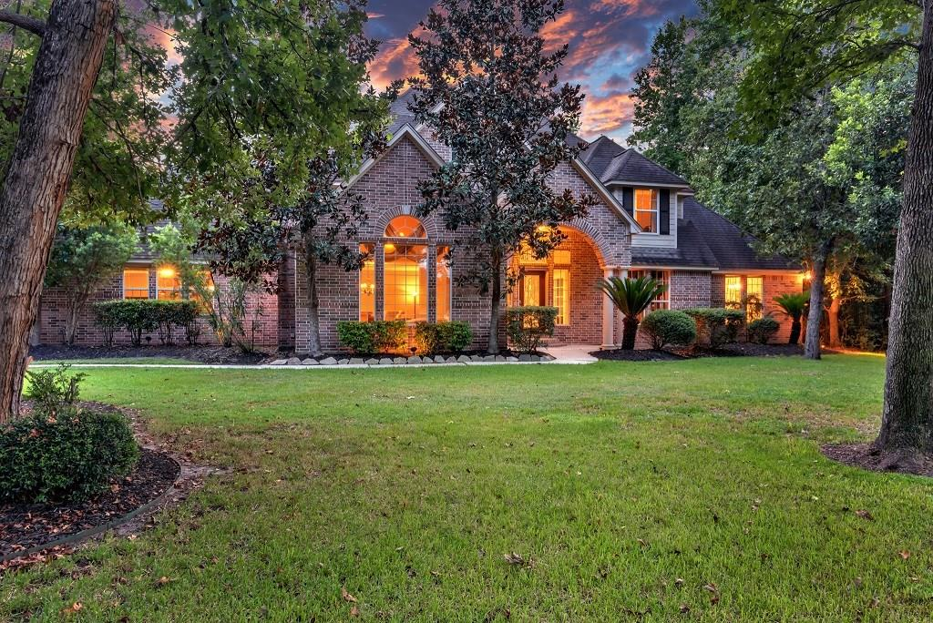 Welcome Home! This gorgeous 4 bedroom 4.5 bath includes a 4 car garage with an oversized tandem; great for boat storage, travel trailer, or car collection!  Beautiful open foyer with high ceilings, wrought iron stair well and cat walk.  Formal living and dining with beautiful stone fireplace and lots of natural light.  Large study with hard wood floors and built in book case.  Family room is perfect for entertaining with 2 story ceilings, crown molding throughout, built in entertainment system, and open to the kitchen.  Kitchen has island, granite counter tops, stainless steel appliances and an abundance of cabinet storage.  Huge game room down stairs with wine grotto!  Energy efficient home with 4 HVAC units and star energy appliances.  Schedule your showing today!