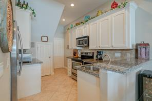 Kitchen with Granite Counter Tops and Stainless Steel sink and appliances.