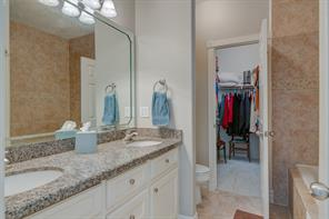 Master Bath has a walk in closet, tub and shower with tile tub on the walls and floor