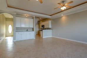 Notice the marble clip inserts in the tile floor Foyer and the beautiful Lead glass front door.  Granite counter with a sink grace this butlers pantry and give lots of extra cabinets and counters to work with