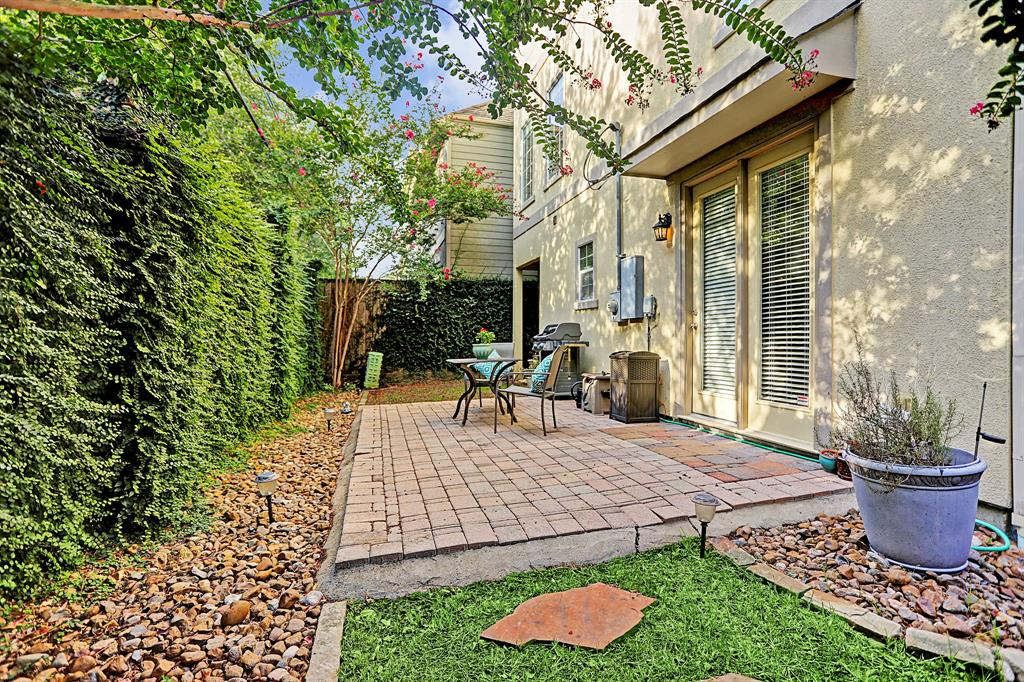 A gated back yard - a rare find for a home of this style. Big enough for outdoor dining and cooking. Surrounded by beautiful crepe myrtles that create some shade and relaxing lighting.