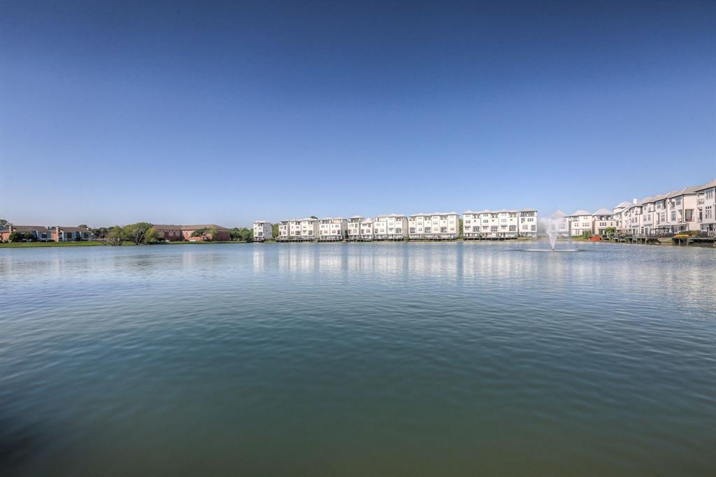 The expansive lake with glistening fountain gives the neighbourhood a peaceful feel.