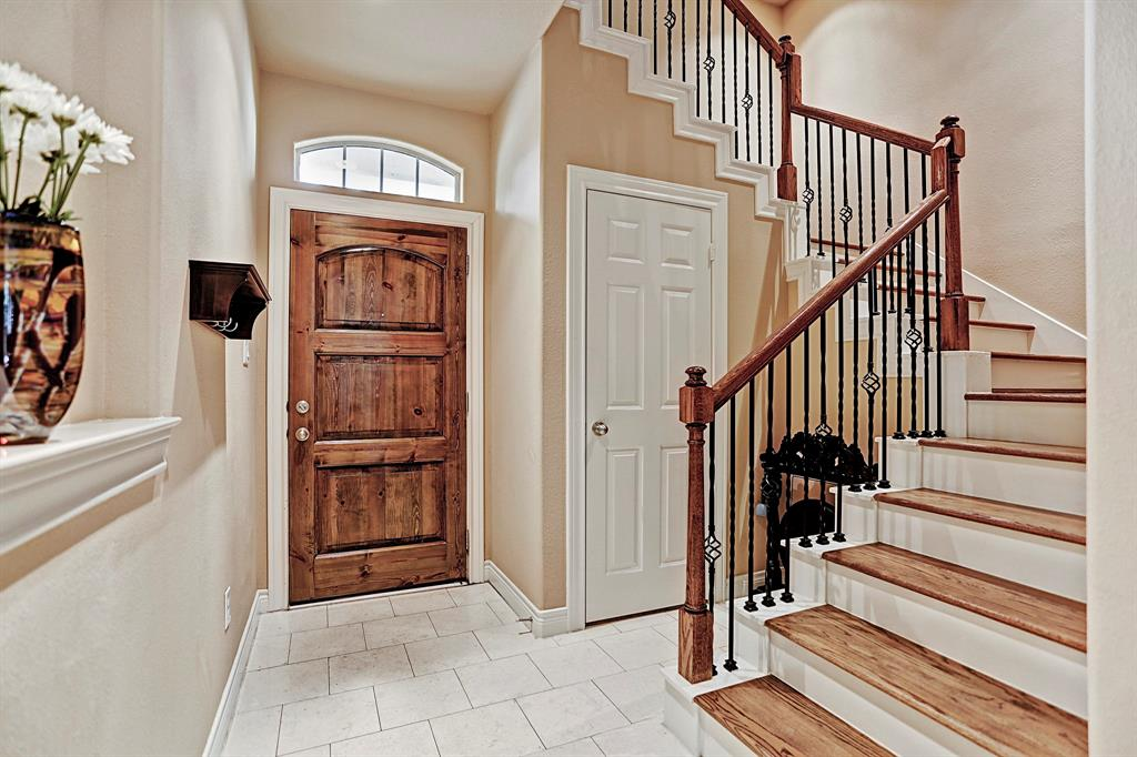 Open and flowing entrance way with beautifully curved staircases. Double storage closets on this lower level.