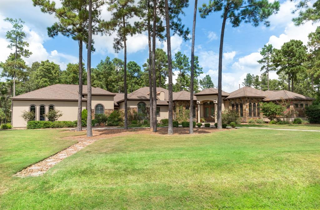 Sprawling one story estate located on a full acre a quiet section of Benders Landing Estates. Within walking distance to clubhouse, pool, splash pad, fitness center, sports park, & playground! Superior architectural design w/great flow for entertaining & hosting holiday gatherings. Enter through double wooden doors into a stately foyer w/formal living. Discover grand arches, vaulted ceilings, faux painting, art niches, gleaming hardwood floors, plantation shutters, custom cabinetry, & granite counter tops throughout the home. Master retreat resides in private wing of the home. Indulge yourself in the spa-like bath w/Roman style jacuzzi tub, HUGE walk-in shower w/multiple control spray systems, & two customized walk-in closets. Generous secondary private bedroom suites include full bath & spacious walk-in closets! Gourmet kitchen w/stainless steel appliances, double ovens, oversized island, & storage galore! Rare plan includes media room & 2 separate outdoor patio spaces. MUST SEE!