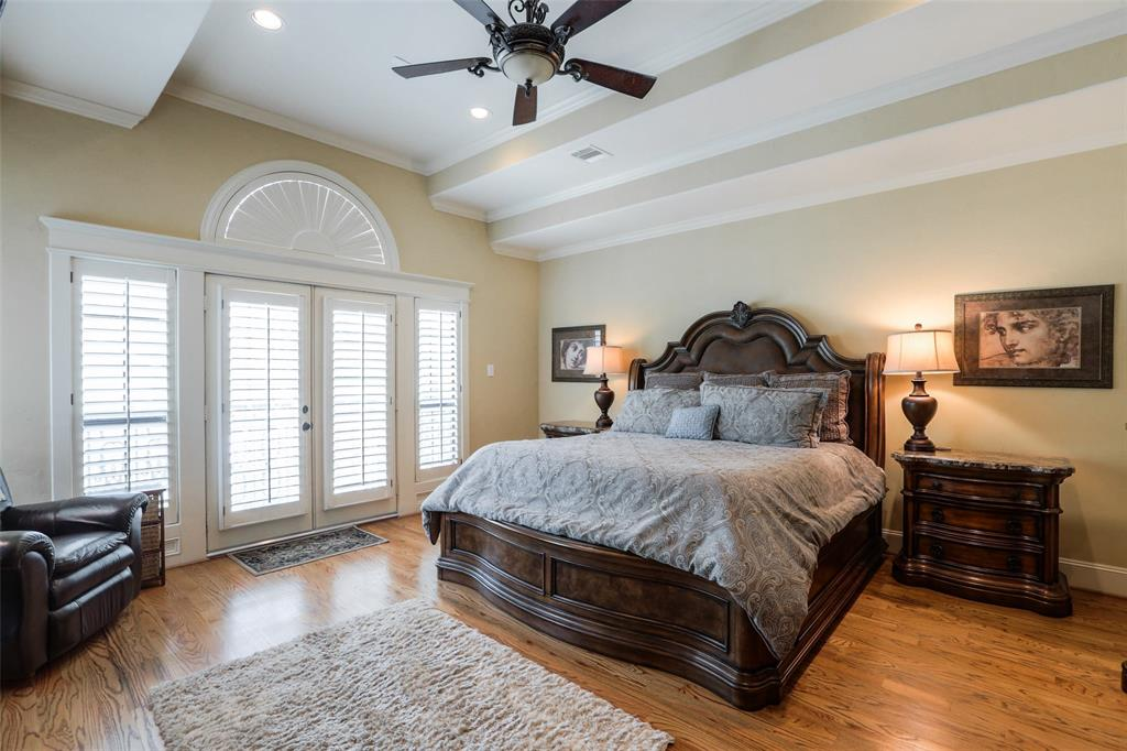The master suite features wood floors, recessed ceiling and lights and a massive walk-in closet.