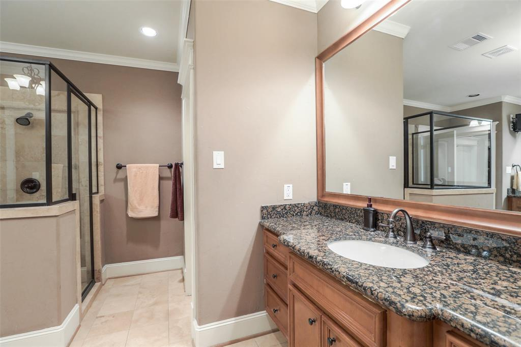 The large master bath offers plenty of space and features granite counter tops with beautiful cabinetry.