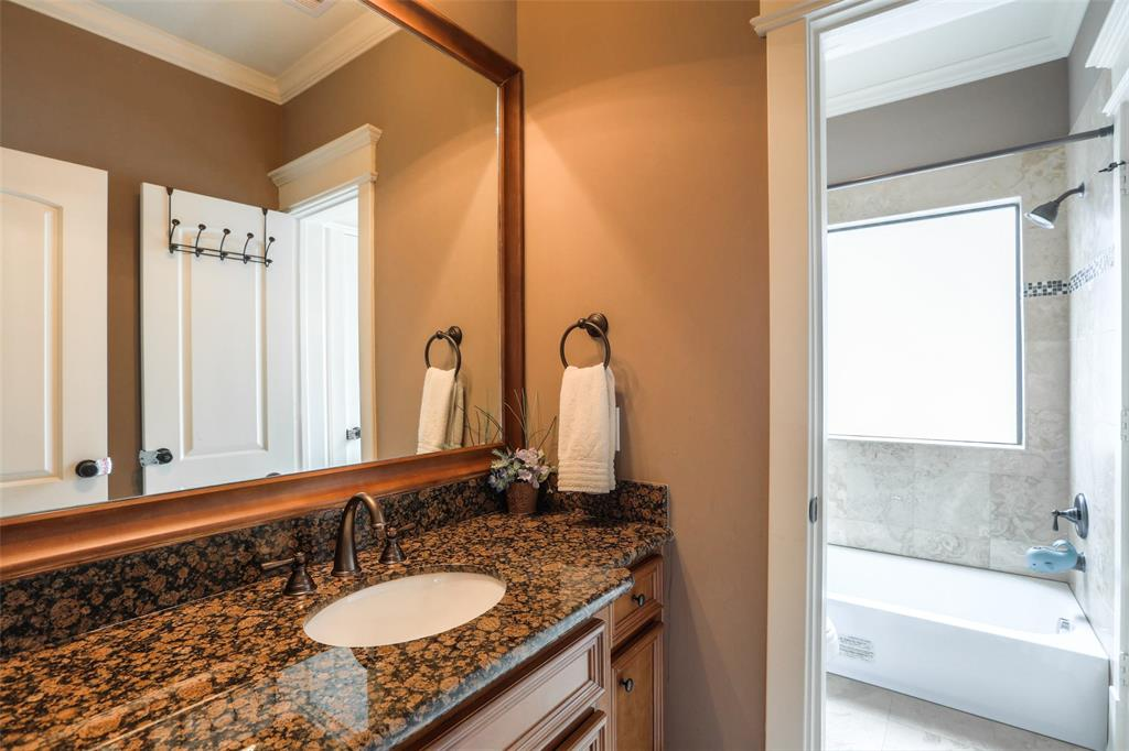 Full bath with dual vanities and granite counter tops.