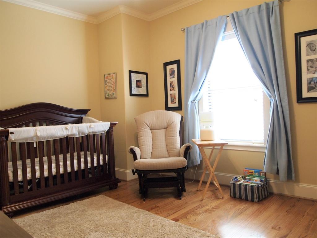 Bedroom # 3 with wood floors.