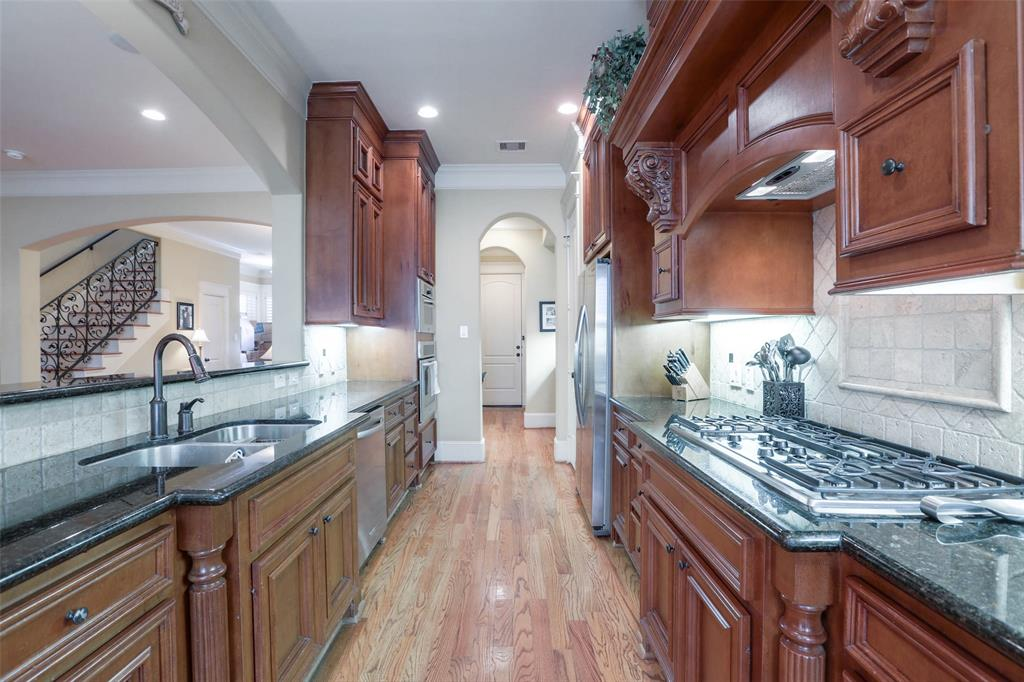 The kitchen features granite counter tops, stainless steel appliances and lots of storage.