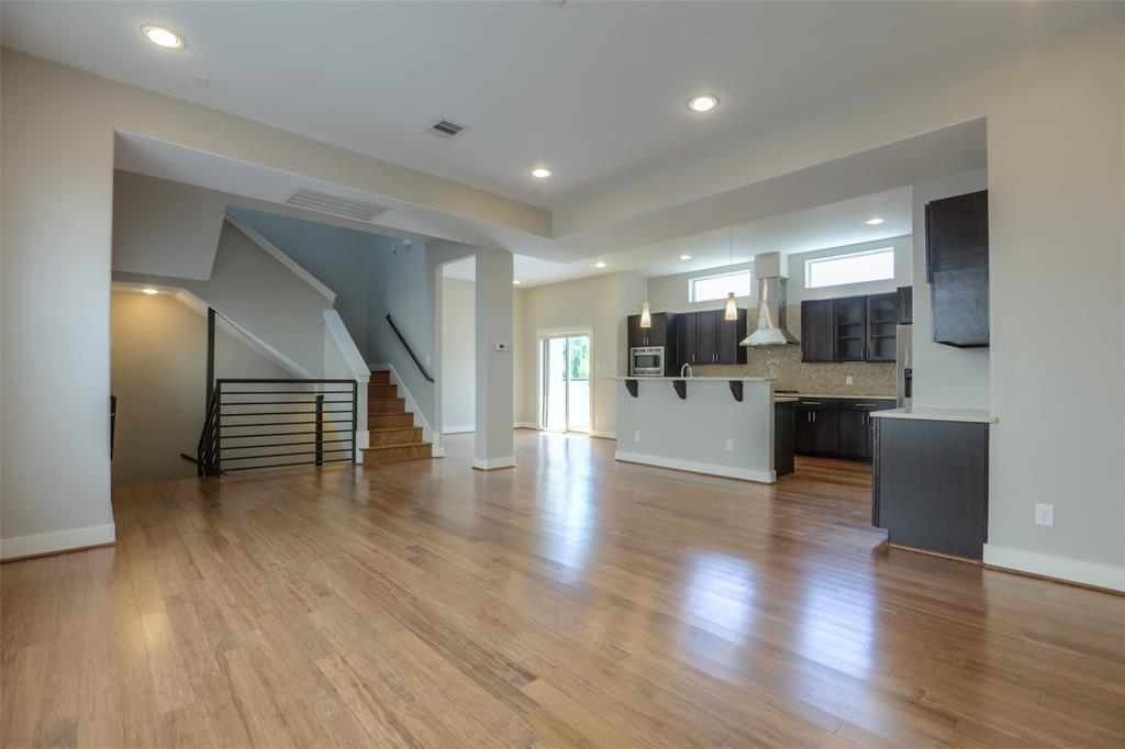 The open floor plan features wood floors and lots of natural light.