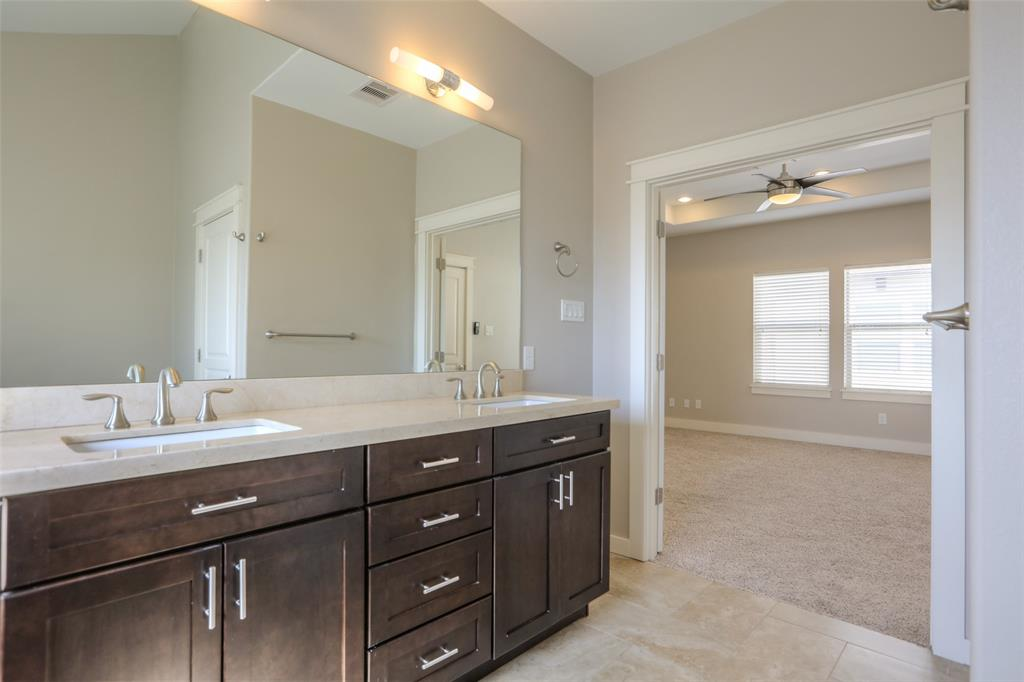 The vanity in the master bath features two sinks and lots of storage