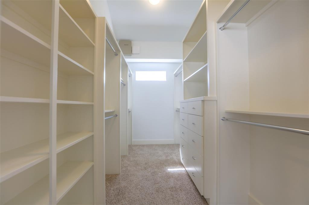 Huge walk-in closet with lots of built-in storage