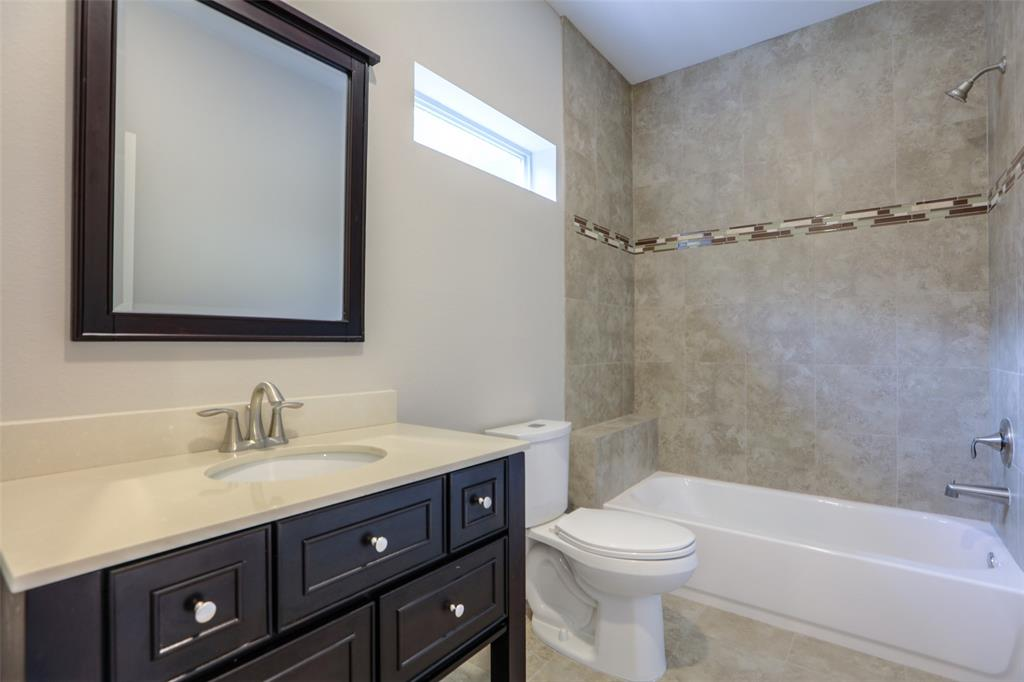 Full bathroom # 2 with modern tile and vanity