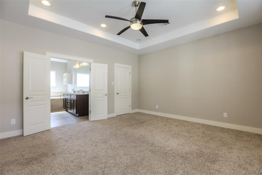 Large master suite with recessed ceiling and lots of natural light