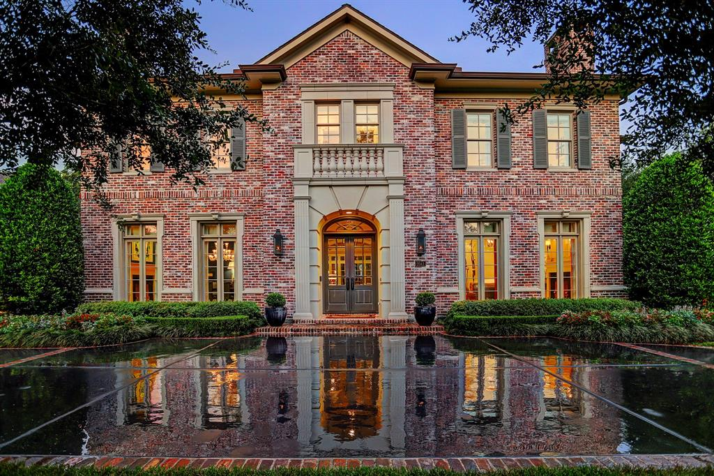 Sophistication meets tradition in this stately River Oaks beauty! Featured in Southern Home Magazine, Elle Décor and The Houston Chronicle. French Oak wide plank hardwoods, walk-in wine vault and extraordinary millwork throughout. Thompson + Hanson used their skilled hand designing a double width circular drive to ensure ample parking for guests and created lush landscaping that encompasses the expansive lot. Dramatic foyer unites the gorgeous formals that are bookended by estate size fireplaces. Library opens to wrap-around veranda while banks of windows and massive fireplace anchor the family room that interconnects with the cook's kitchen that features granite counter tops, Wolf appliances, 2 Bosch dishwashers, 2 pantries, and pull-up breakfast bar. Powder room and master bath ceiling featured in Segreto's latest book. Stunning master is positioned for feeling of secluded removal and has dual marble baths. Game room, homework loft, 4 additional ensuite bedrooms, and a 3 car garage.