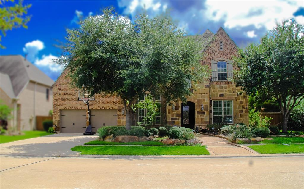 2 Story corner lot former model home in the heart of Aliana subdivision. This 5 bedroom, 4.5 baths by Highland Homes offers plenty of upgrades inside and out, 3 car tandem garage, 4 sided brick, lavish landscaping with beautiful front view of pond and water spray. Home features Brick & stone flooring, High ceiling, Study room with custom bookcase, Formal dining room, open Family room with gorgeous custom crystal Chandelier, Game room, and media room. Spacious kitchen showcases granite counters, kitchen backsplash and espresso cabinetry with double oven. Upstairs you'll find custom sectional wooden bookcases, large area for entertaining with wet bar, media room and separate game room for your convenience. Great size backyard with covered patio, ideal for building swimming pool. Premium location with easy access toclub houses, hiking trails, neighborhood parks, tennis courts, and in close proximity to restaurants, amenities, and schools. Your home search is over, THIS IS IT!