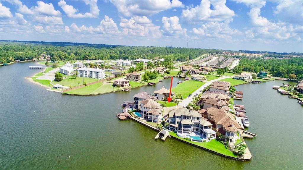 Feel like you're on VACATION EVERY DAY at this WATERFRONT lot in LUXURIOUS Bella Vita. This 54 lot development is prestigious, and has an EXCELLENT LOCATION that gives great access to Lake Conroe. Enjoy the quiet and peaceful settings, and yet be NEAR I-45 for commuting to The Woodlands, IAH, or taking in a show in Houston. This particular lot is on the cusp of WIDE OPEN water views, and is near the dam for great deep water. It's tucked down at the end of a cul-de-sac street with cobblestone pavement and million dollar homes all around you. Choose your builder and build when you are ready! This gated community is beautiful and the location is outstanding. This particular lot is priced very competitive compared to other lots available. Come get it!