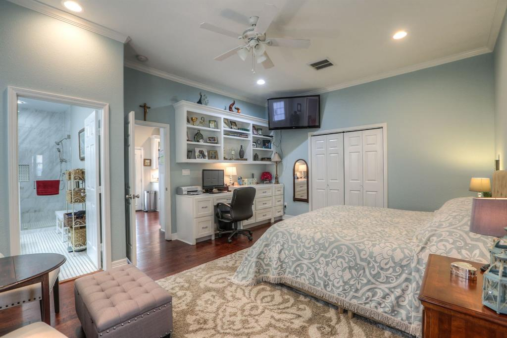 This home has two master-sized bedrooms. This room is the largest, but the size of the 2nd provides a lot of flexibility. The built-ins provide a great study space.