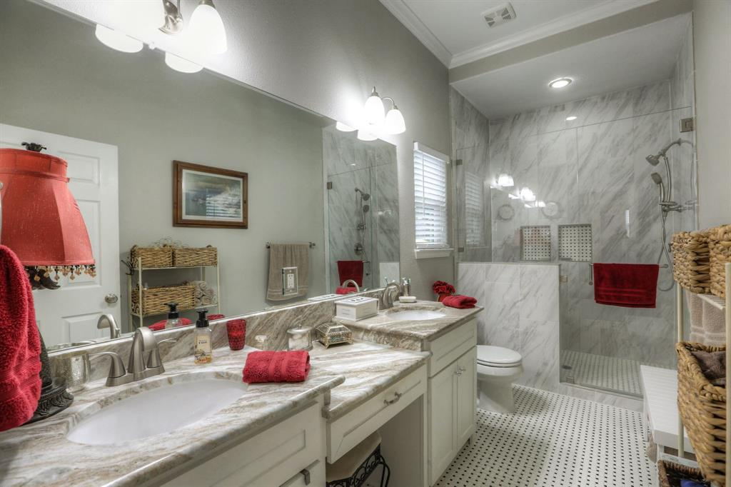 This is the largest of the 2 master sized bedroom. This bathroom includes classic Heights finishes, a huge walk-in shower, granite countertops, frameless shower door and a double sink vanity.