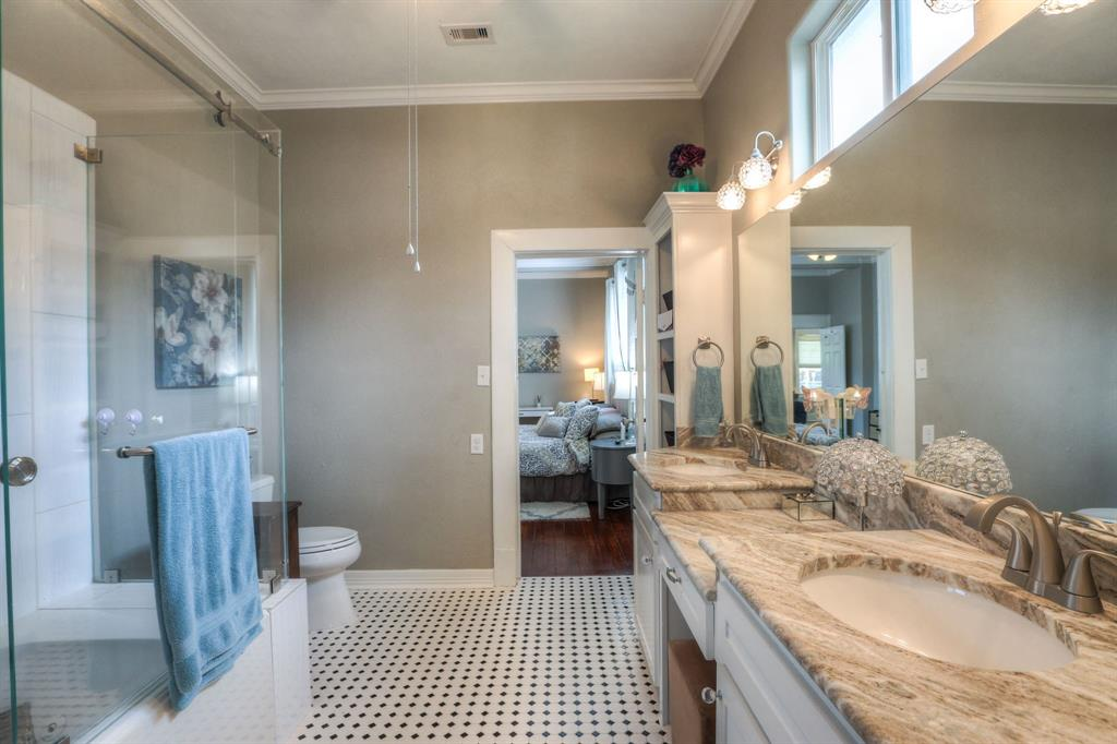 This is the 2nd of the large master-sized bathroom, located just off the bedroom. As you will see, this bathroom also features a large double sink vanity frameless shower doors, and a large jetted tub. Also, check out the windows just below the ceiling. This bathroom provides an inviting space for you or your guests to start their morning.