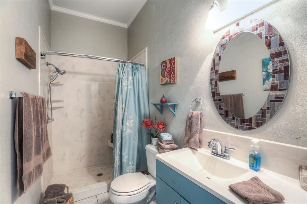 This full bathroom is located just off the main living space and functions as a powder room for guests or a 3rd full bathroom for guests.