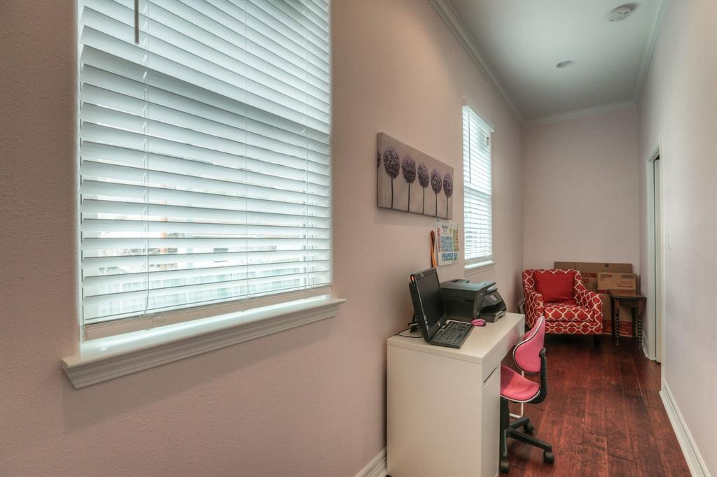 This bonus space connects the two master suites and offers a great space for a study or reading space. It could also be used as additional walk-in closet space for either or both bedrooms.